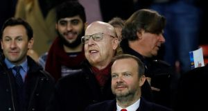 Neville warns Woodward after United fans attack Ed